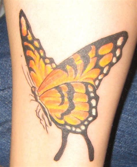 tattoo butterfly yellow forearm yellow butterfly tattoo tattooshunt com
