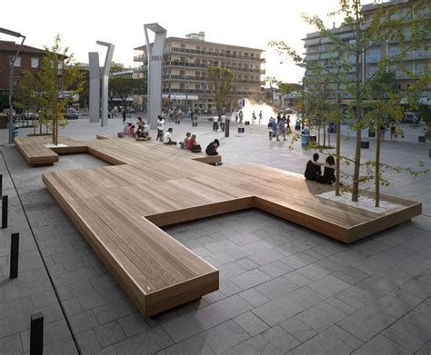 architecture and design how to build a furniture brand with a large bench serves as a gathering place in this town