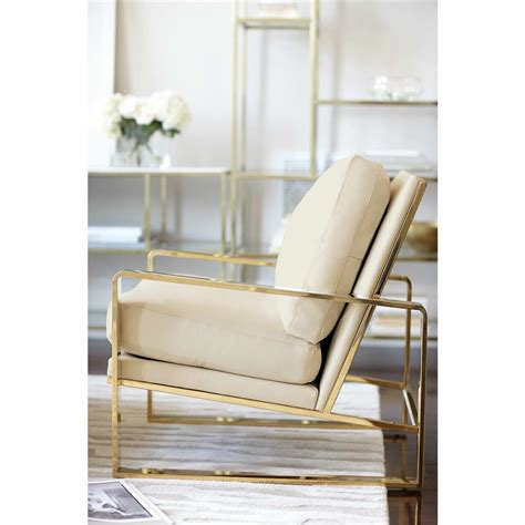 gold armchair brea hollywood regency cream leather gold metal armchair
