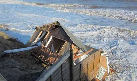 houses falling off cliffs flood alerts remain after worst coastal surges since the 1950s uk news express co uk