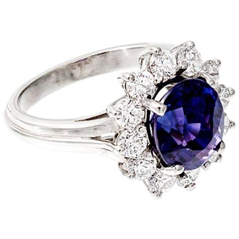 oval blue purple sapphire halo engagement ring for