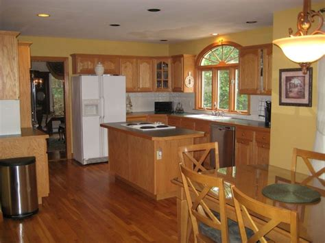 mustard paint with honey oak kitchen warm paint colors and kitchen paint colors