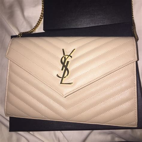Yes Laurient Woc So Black 6 yves laurent handbags ysl woc from jeannie s closet on poshmark