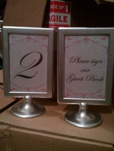 silver frames for wedding table numbers fs ikea tolsby frames painted the knot