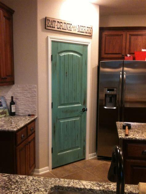 turquoise distressed pantry door painted pantry doors