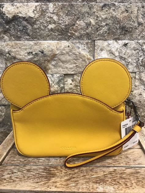 details about disney x coach mickey mouse leather ears wristlet banana yellow f59529 nwt