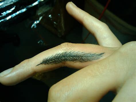 tattoos for fingers design feather on finger designs ideas and meaning