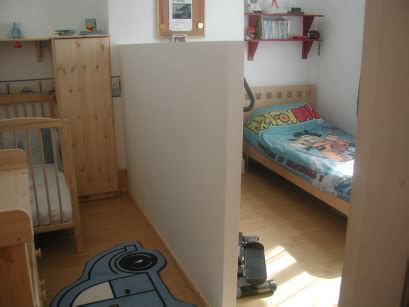 split bedroom into two splitting a room in 2 with a half height partition wall