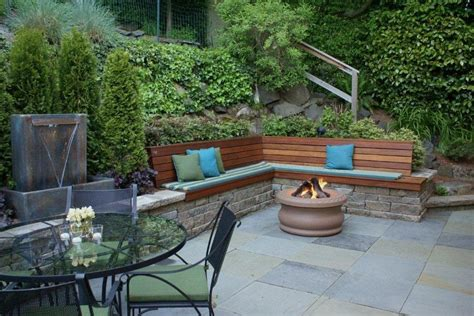garden retaining wall bench bluestone terrace with gas ring water feature
