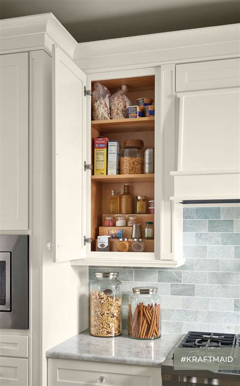 who makes kraftmaid cabinets a tiered storage shelf in the kitchen makes canned goods