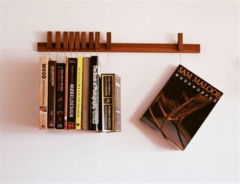 custom made wooden book rack bookshelf in walnut pins also