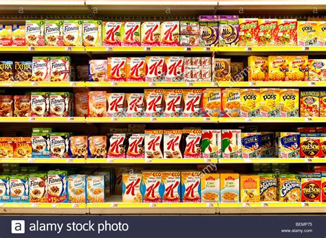 Supermarket Box boxes of branded breakfast cereals on supermarket shelves stock photo royalty free