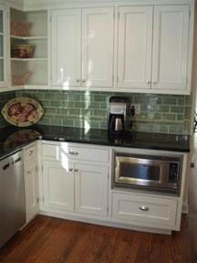 inset painted white cabinet doors built in microwave in