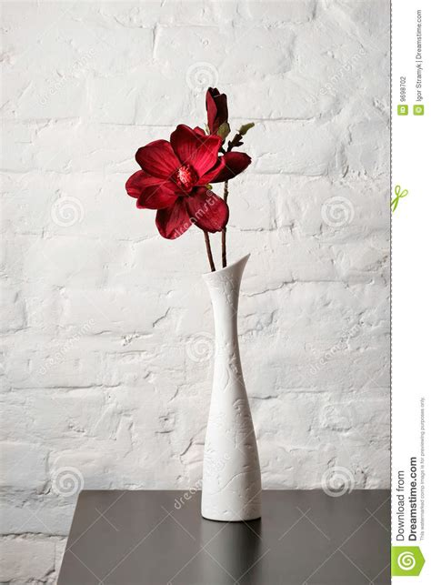 white flower table l flower in the white vase on the table stock photo image