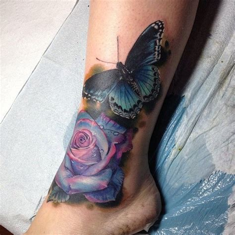 butterfly on a rose tattoo beautiful color purple y blue with a gorgeous
