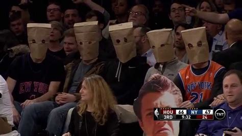 new york knicks fans knicks fans wear paper bags on their heads houston