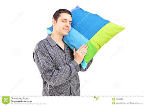 Holding Pillow While Sleeping by A Lazy Holding A Pillow And Sleeping Stock