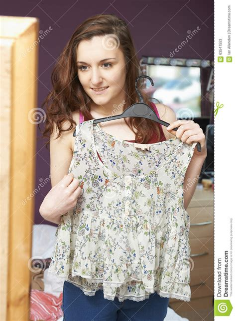 bedroom wear for ladies teenage girl in bedroom choosing clothes to wear stock