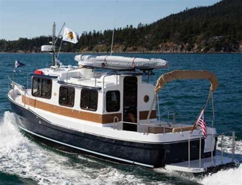 livable tug boats for sale ranger tugs r 27 a mini trawler that maximizes space