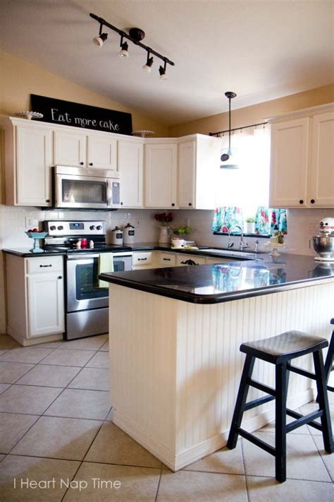 i want to paint my kitchen cabinets want to increase a home s value here s the top 5 projects