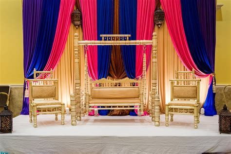 Gold, blue and pink Indian wedding stage decor   Mendhi