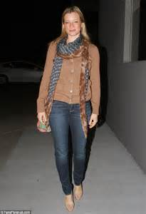Amy Smart Dresses Up Her Brown Top And Blue Jeans With