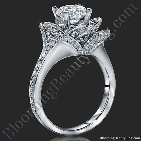 the small crimson flower engagement ring