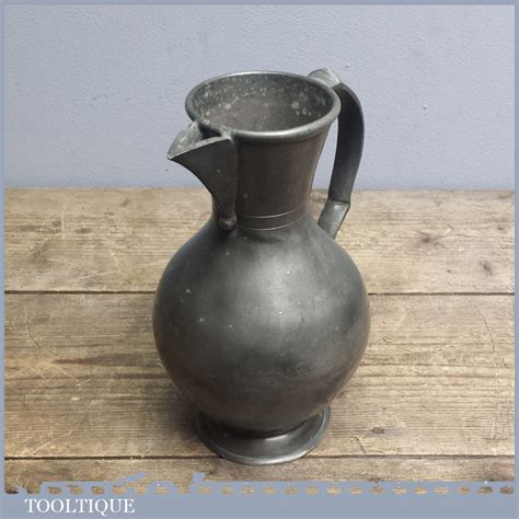 antique pewter jug  touch marks  pouring vessel
