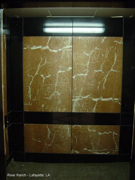Travertine Elevator Interiors by Panels Inc River Ranch