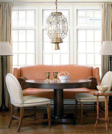 couch in kitchen nook settee paired with a round dining table debbie partyka