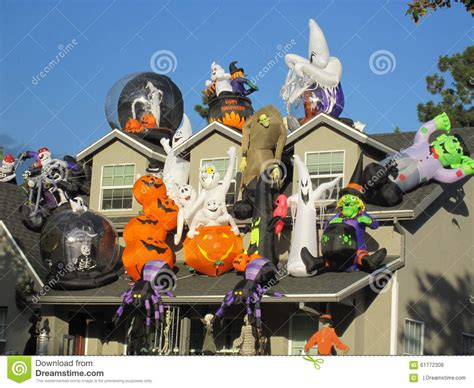house covered in huge halloween decorations stock photo