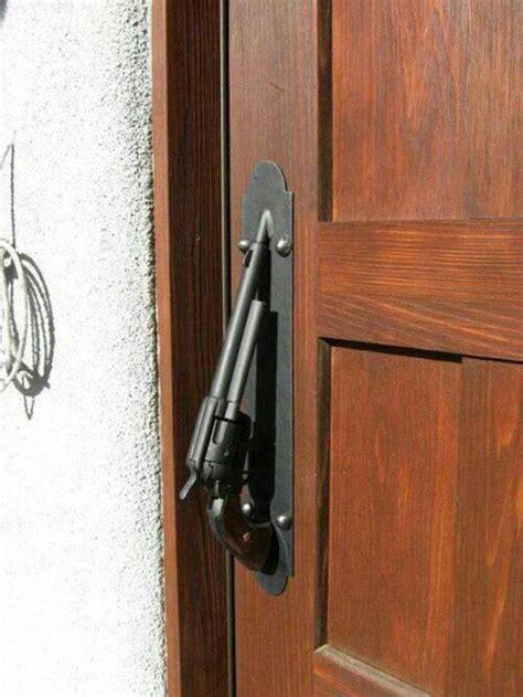 gun door handle revolving door handle caption contest 70 guns ammo