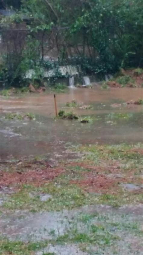 how to stop water runoff from neighbors yard flooding yard