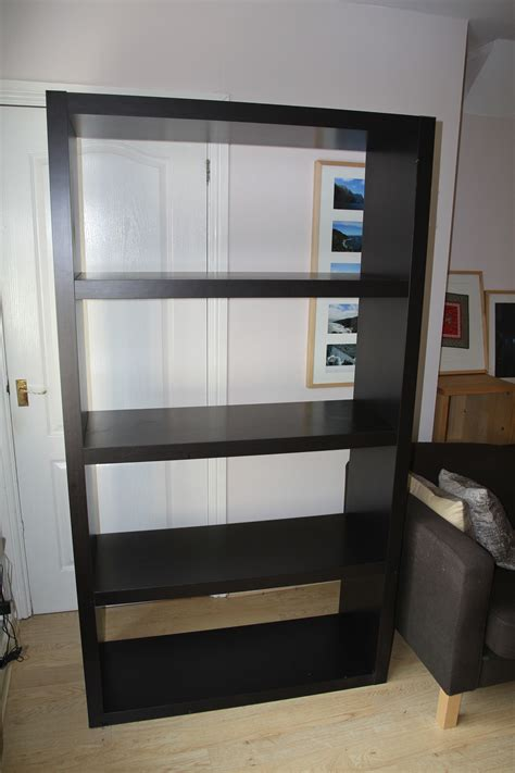 large ikea bookshelf shelving unit in black brown