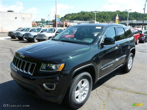 green jeep cherokee 2014 black forest green pearl jeep grand cherokee laredo