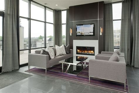 glass enclosed fireplace orion condominium grand opening scheduled for august 4th