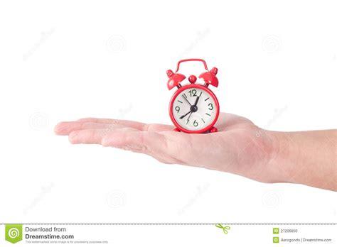 tiny alarm clock  hand stock photo image  palm
