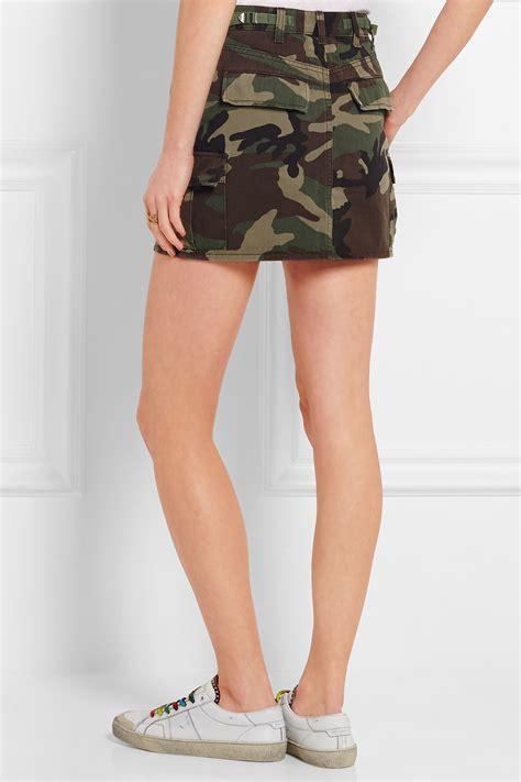 laurent camouflage print denim mini skirt in green