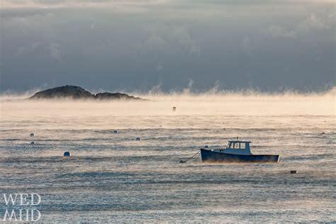 sea smoke lobster boat encircled by sea smoke marblehead ma