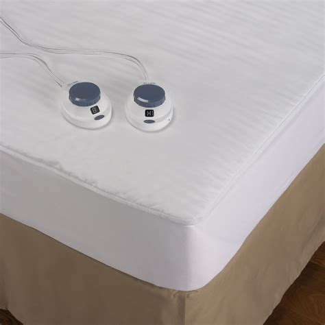 heating pad for bed the best heated mattress pad hammacher schlemmer