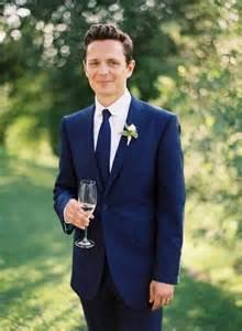 Blue suit groom once wed
