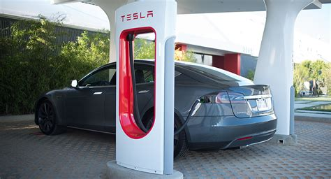 tesla will open its supercharger patents to promote evs