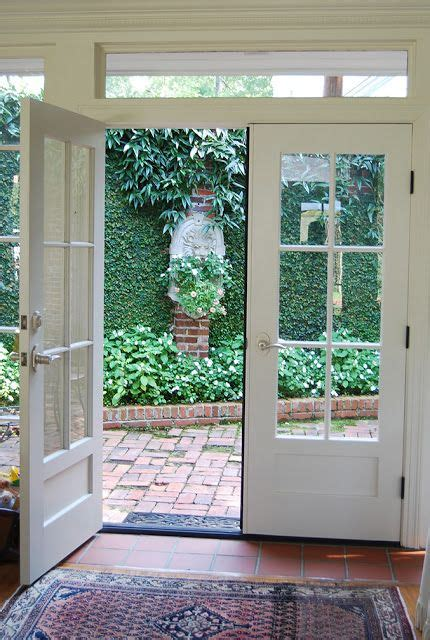 french doors opening onto a courtyard my beautiful house