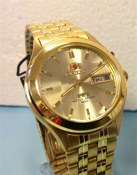 Orient Kombinasigold New For new orient day date automatic s gold tone gold orient box warranty ebay