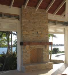 outdoor fireplace limestone and wood mantel craftsman