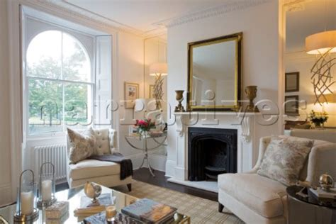 living room mirrors uk rs005 01 gilt mirror on fireplace of living roo narratives photo agency
