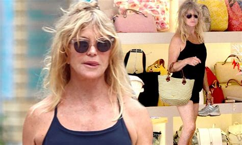 Goldie Black goldie hawn sports black mini skirt for shopping spree in