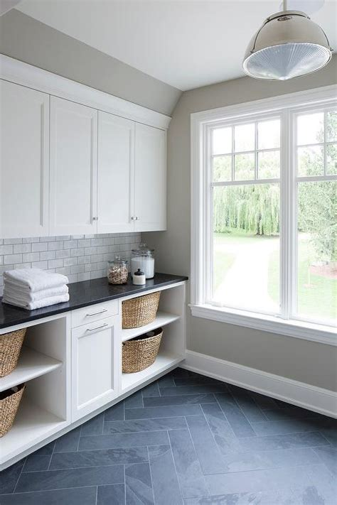 laundry room floor cabinets white laundry cabinets with gray slate herringbone floor