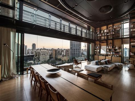 industrial loft decor prestigious industrial loft ideas with amazing city view on window with large bookcase on the