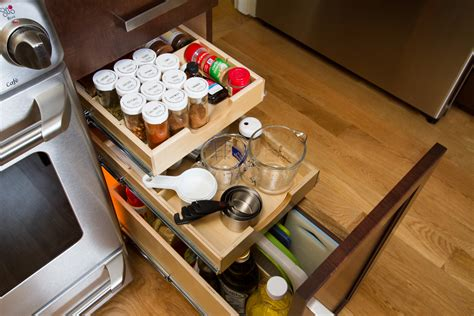pots and pans roll out kitchen drawer organizers minneapolis by mid continent cabinetry shelfgenie of mississauga hamilton designs custom slide